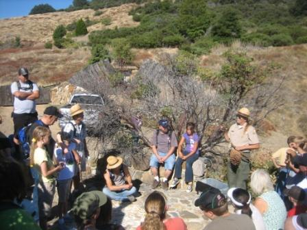 Ranger Bobbi Thompson speaking to hiking group